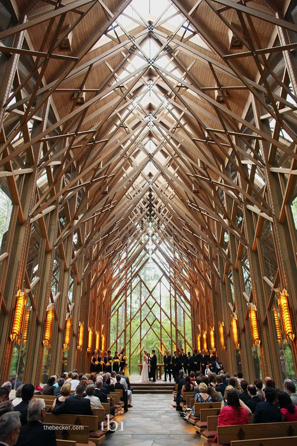 I've always wanted to get married outdoors, but this is probably the best of both worlds. Wow. Glass Chapel in the woods in Arkansas