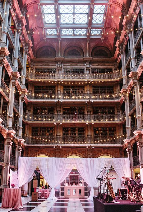 The George Peabody Library in Baltimore, Maryland has cast-iron columns and gold-leaf embellishments | Brides.com