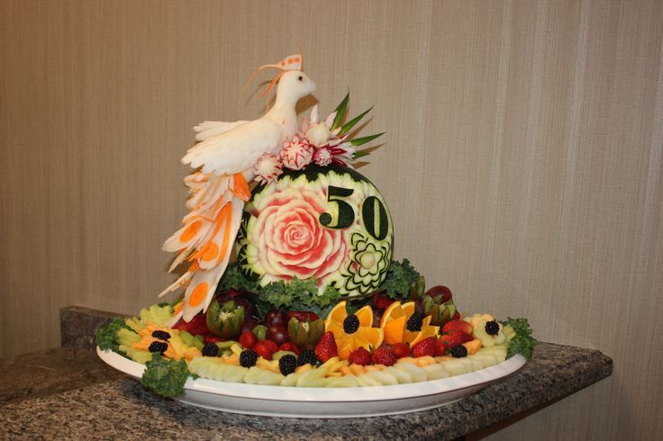 Peacock sculpture on a personalized watermelon carving and platter