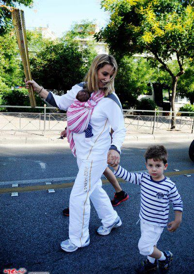 Carrying the Olympic Torch, two-times Olympic medalist, Sofia Bekatorou, with her newborn baby in Asteraki Ring Sling