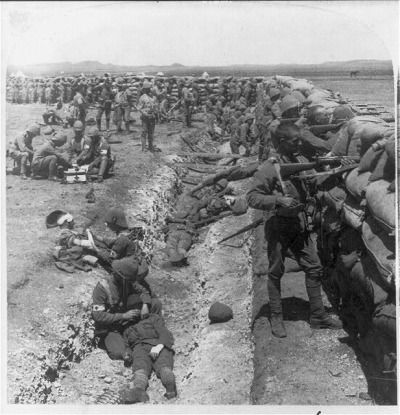 Royal Munster Fusiliers fighting from behind the redoubt at Honey Nest Kloof, South Africa. Feb. 16, 1900 (Library of Congress)