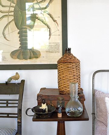 On a bedside table, a handblown carafe from Lebanon and a wicker-covered bottle, both from Derian's store.