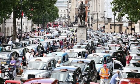 The sharing economy is increasingly popular but not without problems, as the taxi protest against Uber shows. Photograph: Peter Macdiarmid/G...13.614
