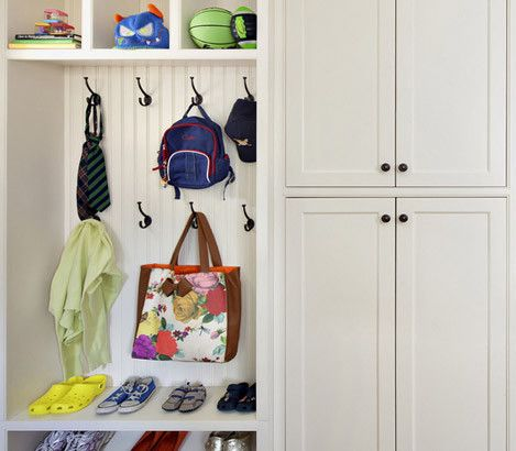 How to Organize Your Coat Closet...almost perfect idea from picture, everyday use items out and other coats and stuff behind doors, get rid of bench in foyer