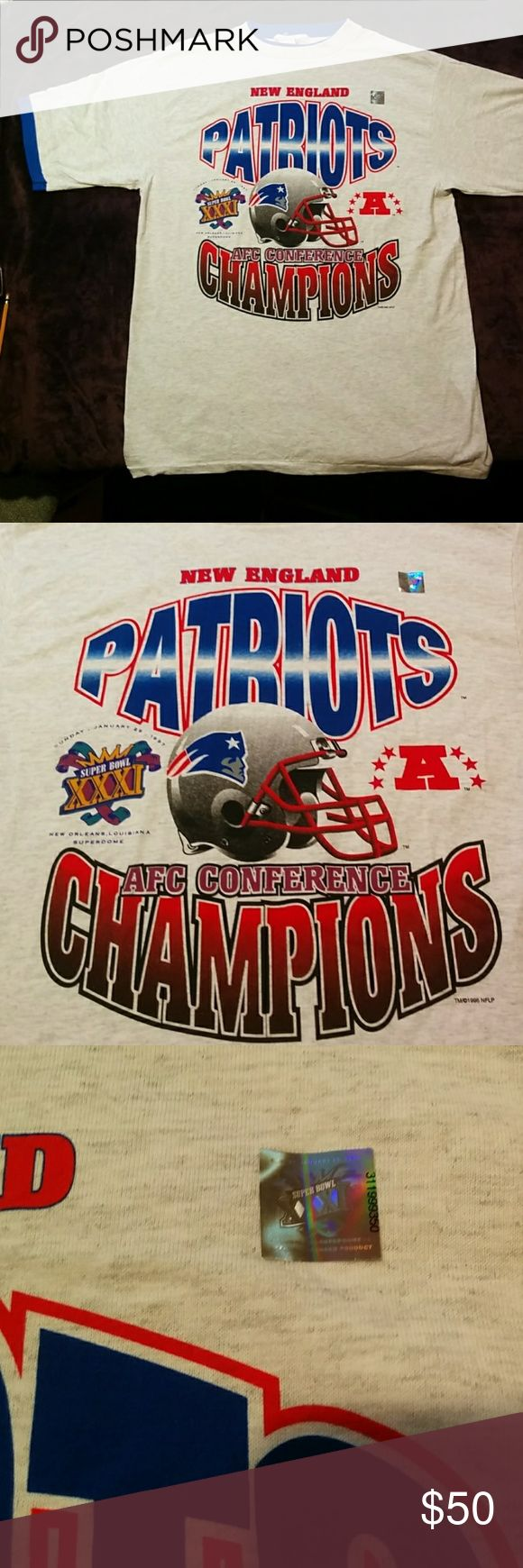 Vintage 1997 New England Patriots Superbowl Shirt VERY VERY RARE New Old Stock Never Worn (Still has stickers on it) NEW ENGLAND PATRIOTS 1997 Superbowl XXXIX Layered T Shirt . Shirt is Grey with 2 tone layered blue underneath. Size is Men's XL TRUE FIT True-Fan Shirts