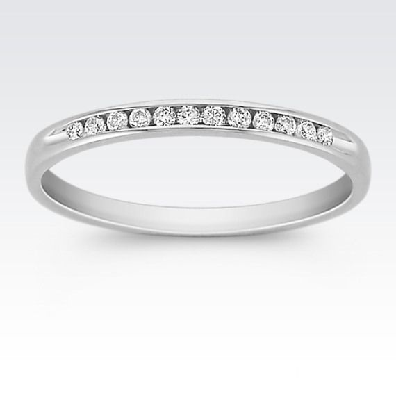 This Quality 14 Karat White Gold Band Sparkles With Twelve Round Channel Set Diamonds