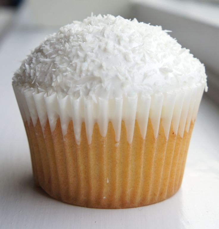 Coconut snowball cakes, coconut cupcake, white chocolate ganache ...