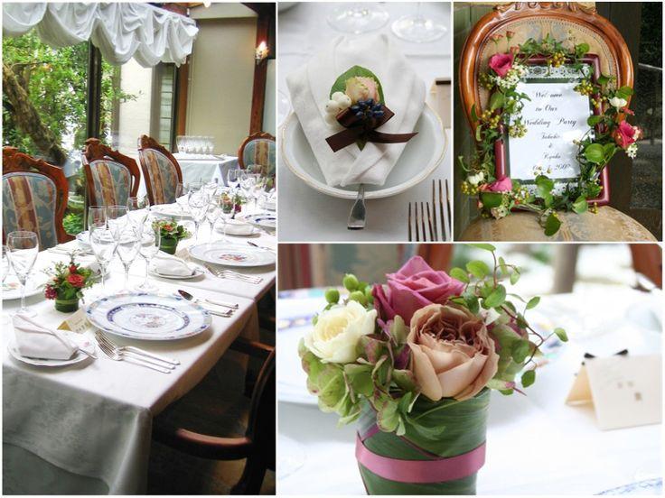 紅茶色やスモーキーピンクのバラ等のニュアンスカラーを使ったシックな会場装花です。