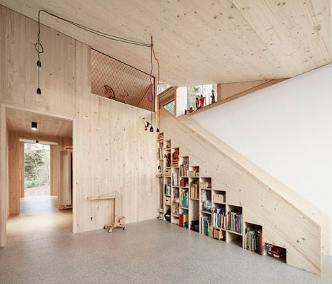 1960s house enveloped in a new timber and concrete facade.