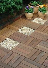 ikea decking squares, for using in the bathroom with rocks under and around the…
