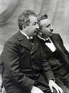"The Lumière (pronounced: [lymjɛːʁ]) brothers, Auguste Marie Louis Nicolas [oɡyst maʁi lwi nikɔla] (19 October 1862, Besançon, France – 10 April 1954, Lyon) and Louis Jean [lwi ʒɑ̃] (5 October 1864, Besançon, France – 6 June 1948, Bandol), were among the first filmmakers in history. They patented the cinematograph, which in contrast to Edison's ""peepshow"" kinetoscope allowed simultaneous viewing by multiple parties."