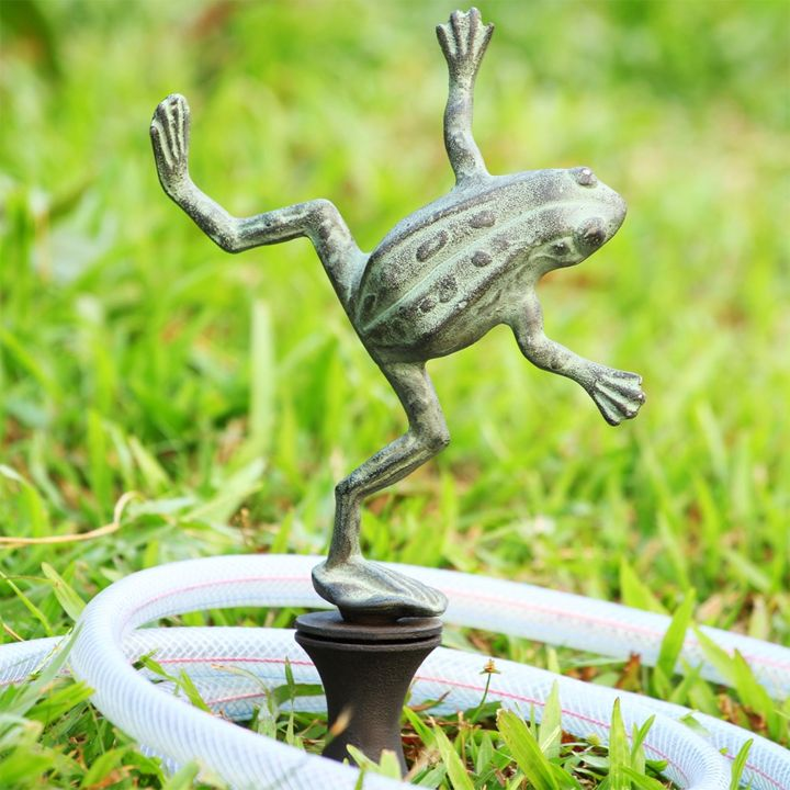 We're not exactly sure what kind of move he's bustin', but it appears to be a little hip-hop!  Secure his base into the yard and nineteen inches of aluminum green artiste will keep your hose from doin...