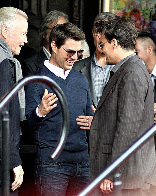 Tom Cruise greets Johnny Depp at the Jerry Bruckheimer Walk of Fame Ceremony on June 24 in Los Angeles. My main man, Deppy Boy! Jon Voight wants in on the handshake action too!