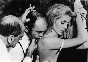 Director Luis Bunuel, Michel Charrel and Catherine Deneuve on the set of  Belle de Jour, 1967
