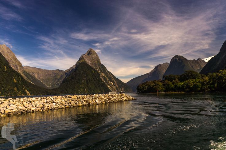 Mitre Peak, Milford Sound, Fiordland National Park • New Zealand   Mitre Peak is with its 1682 meters above sea level the highest mountain in the Fiordland Nationalpark. It got its name due to its shape reassembling the mitre of a bishop.  Pentax K20D •1/250sec •f/8 • 27mm •ISO 100 • smc Pentax-DA 18-55mm f3.5-5.6 AL II