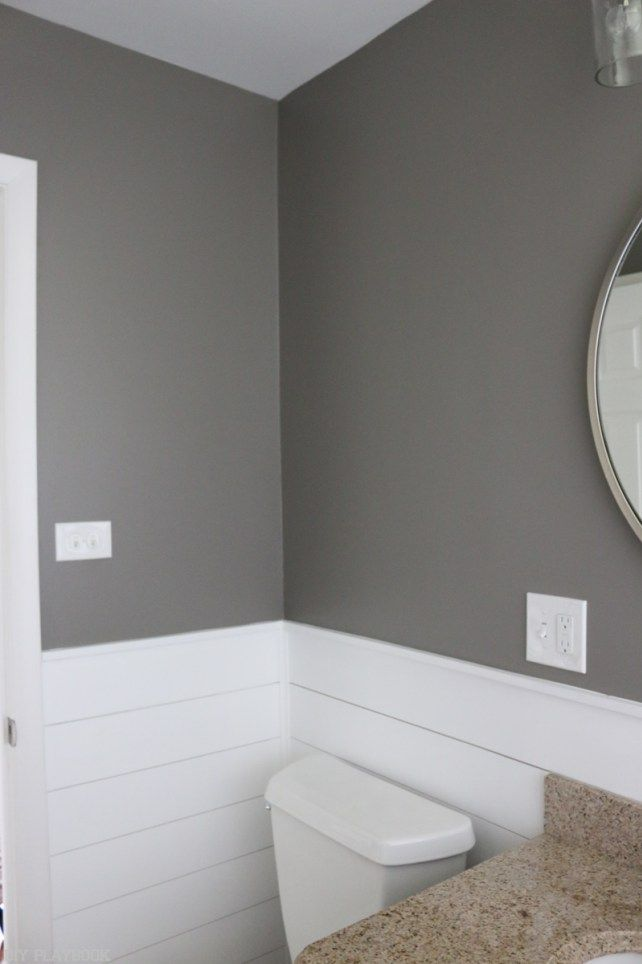 "This bathroom is painted in Behr's ""Creek Bend"" and I absolutely love this moody gray. Such a great color in this small space."