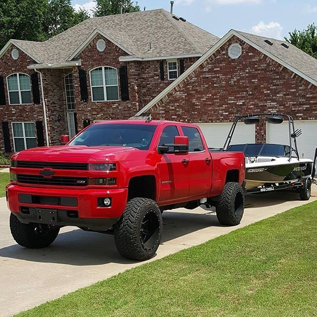 Red lifted blacked out chevy Silverado 2500hd duramax diesel towing a boat... freaking sweet picture