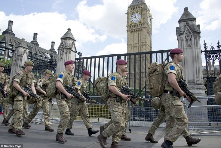 Soldiers from the Parachute Regiment and Irish guards arrive at Parliament today as troops are deployed around Britain. [962 x 641]