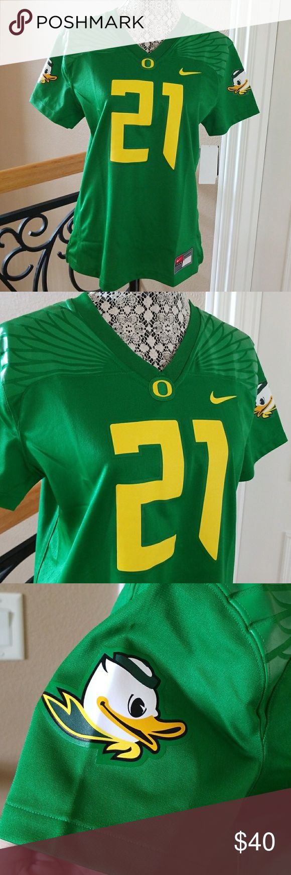 """NWT Nike Oregon Ducks game day jersey Brand new with tags ladies University of Oregon Ducks game day jersey. V neck with Oregon Duck on both shirt sleeves. Split side seams. Measures 25"""" shoulder to hem. Size small. Nike Tops Tees - Short Sleeve"""