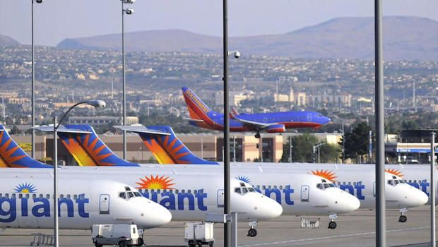 Allegiant Air pilot pleads with tower to make emergency landing at closed airport - CBS News