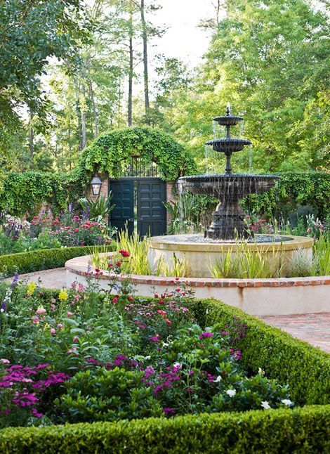 Landscape architect Helen Grivich created a courtyard featuring a New Orleans style fountain at its center for this lovely Houston garden. (Traditional Home)