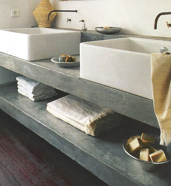 cement countertops and open shelf Neutral tone towelling
