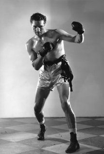 Prizefighting's Heavyweight Champion of the World for 364 days. He knocked out champion Primo Carnera on 14 June 1934, but lost a title decision to Jimmy Braddock on 13 June 1935. Later, he appeared in films and on television, often portraying ruffian types. (Easy for a man who in his boxing career had inflicted 50 KOs.) Father to Max Baer Jr. better known as Jethro Bodine in the Beverly Hillbillies.