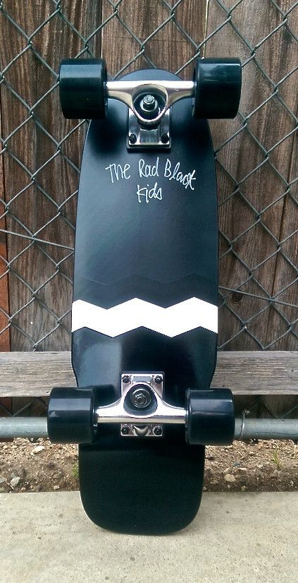 Longboard cruiser hand-finished in America surf inspired street skateboard weatherized strand locker board.