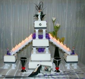 Square Formal Wedding Cake with Stairs - Elegant 4-tier square wedding cake with stairs leading down to 2 satelite cakes adorned by black ribbons and purple African violets