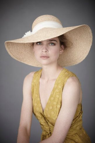 Cousin Susie looked really pretty in the hat she wore last year. Who took this pic? It looks so formal.........