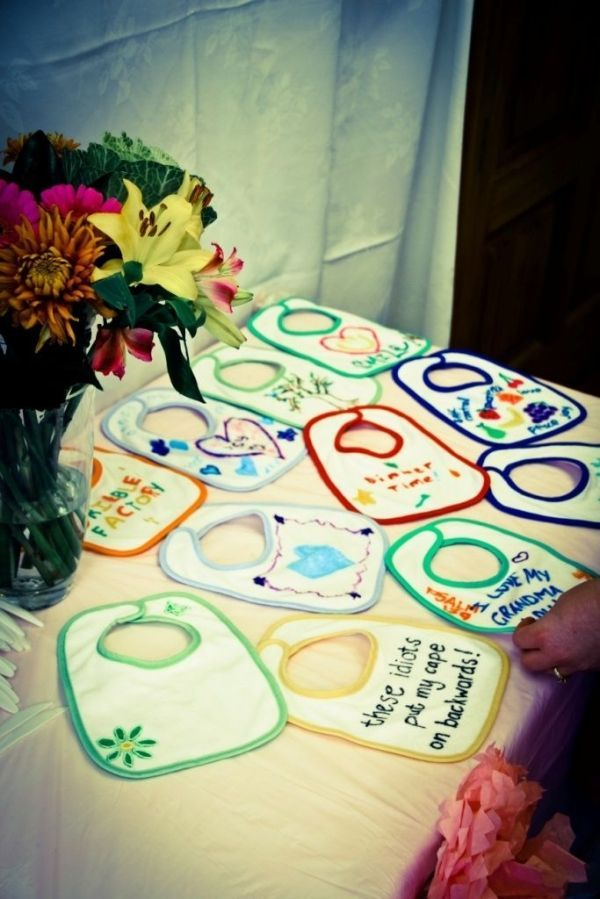 baby shower game: Get fabric pens and each guest personalizes a bib for the baby ( would be better if u put groups of 2 or 3 and put funny sayings only ) my ideal for my shower by britt13