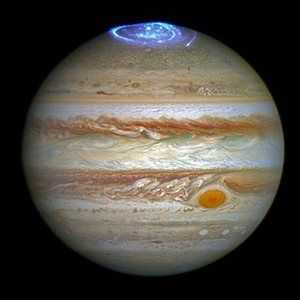 Jupiter appearing to be wearing a luminous crown in this Hubble Space Telescope image showing an aurora over one of the planet's poles.
