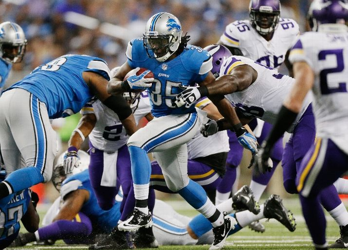 Joique Bell #35 of the Detroit Lions tries to find extra yards on a first quarter run while playing the Minnesota Vikings at Ford Field on September 8, 2013 in Detroit, Michigan. (Photo by Gregory Shamus/Getty Images)