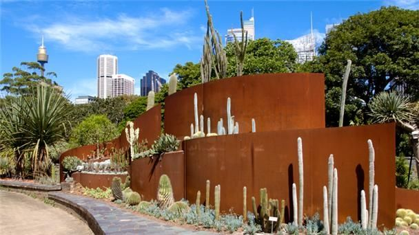 Jamie Durie's sculpture planted with natives from the arid-desert parts of Australia at Royal Botanic Gardens Sydney uses Cortex steel to great use.  Here, the CorTex is used like retaining walls and gives great texture and color to a grayish plant scheme
