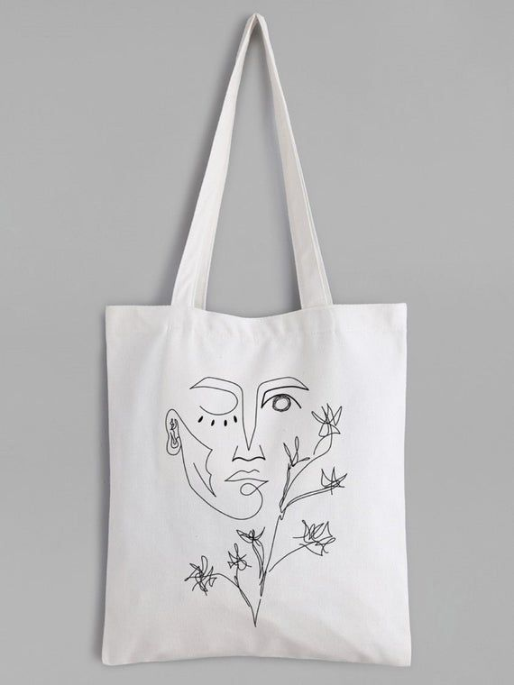 Hand embroidered feminist tote bag shopping bag made from recycled cotton