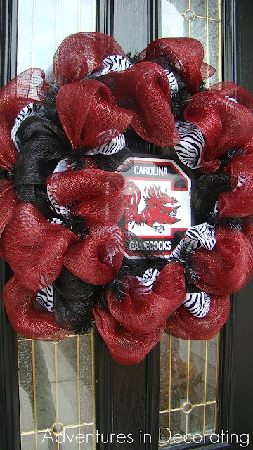 I don't go all out with Carolina stuff but this has to be the Cutest Carolina wreath I've ever seen. Love the zebra in it :)