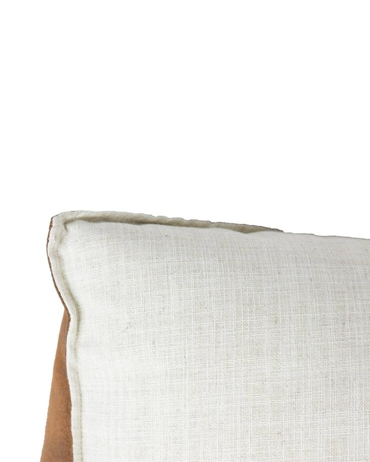 Large puf white Gie El Home A large pouf made from ecological leather and white fabric with linen.  The perfect supplement to your industrial living room, this linen, eco leather pouffe features a rustic design and stenciled detailing.