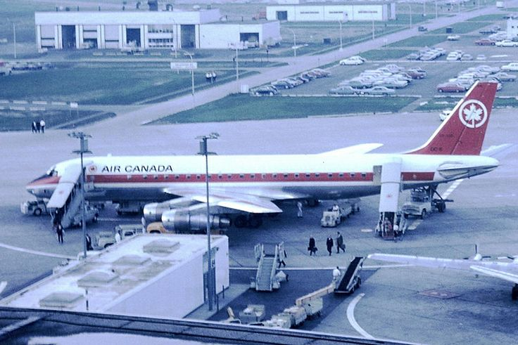 Boarding an Air Canada Airplane at Toronto Airport on the tarmac in June 1963. There was very little security 50 years ago when flying. Also a staff parking lot was located next to the terminal.