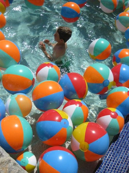 This would be fun even without the pool.  My girls would love to see beach balls all over the yard (along with every water toy known to man)!
