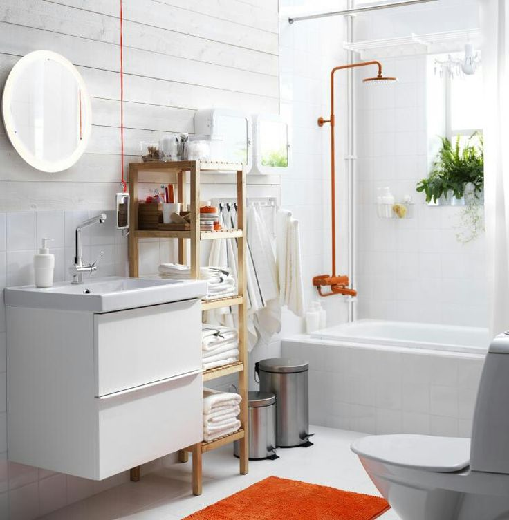 Attirant View Of The Bathroom. White Suite And Walls, Wooden IKEA Shelving Unit And  Orange Shower.