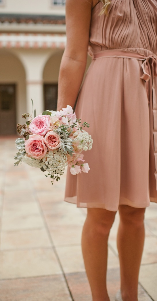 Bridesmaids bouquet of pink sweet pea, pink garden roses, pink spray roses,  queen anne's lace, hydrangea, dusty miller and eucalyptus berry.