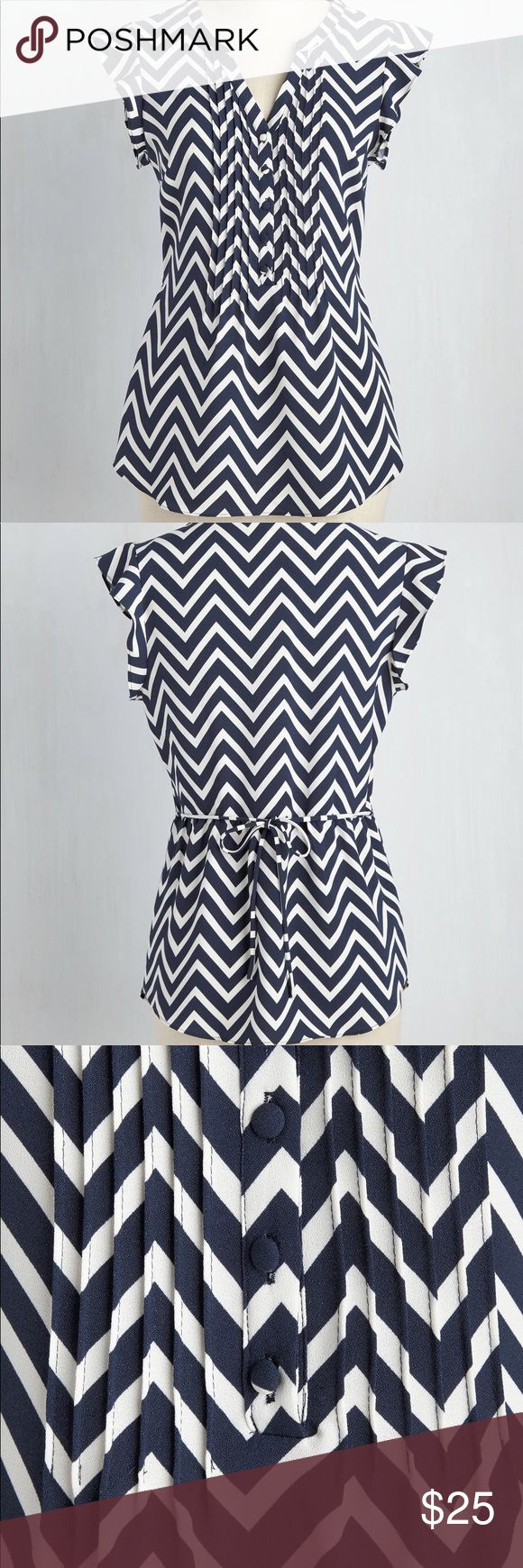 Expert in Your Zeal ModCloth ButtonUp Chevron Top ModCloth white and navy chevron top with nice ruffles on the front, amazing for the office or for getting together for brunch with friends! Looks great by itself or layered underneath a cardigan or sweater! Perfect condition, only worn 2 or 3 times. Modcloth Tops Blouses