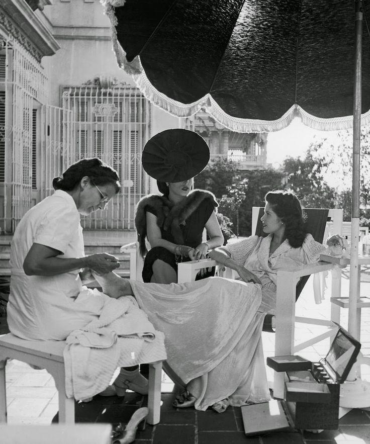 Cuban Socialite Aline Johnson and friend Nina Gomez de Freyre receiving manicures. Havana, Cuba 1946. Photographer- Nina Leen.