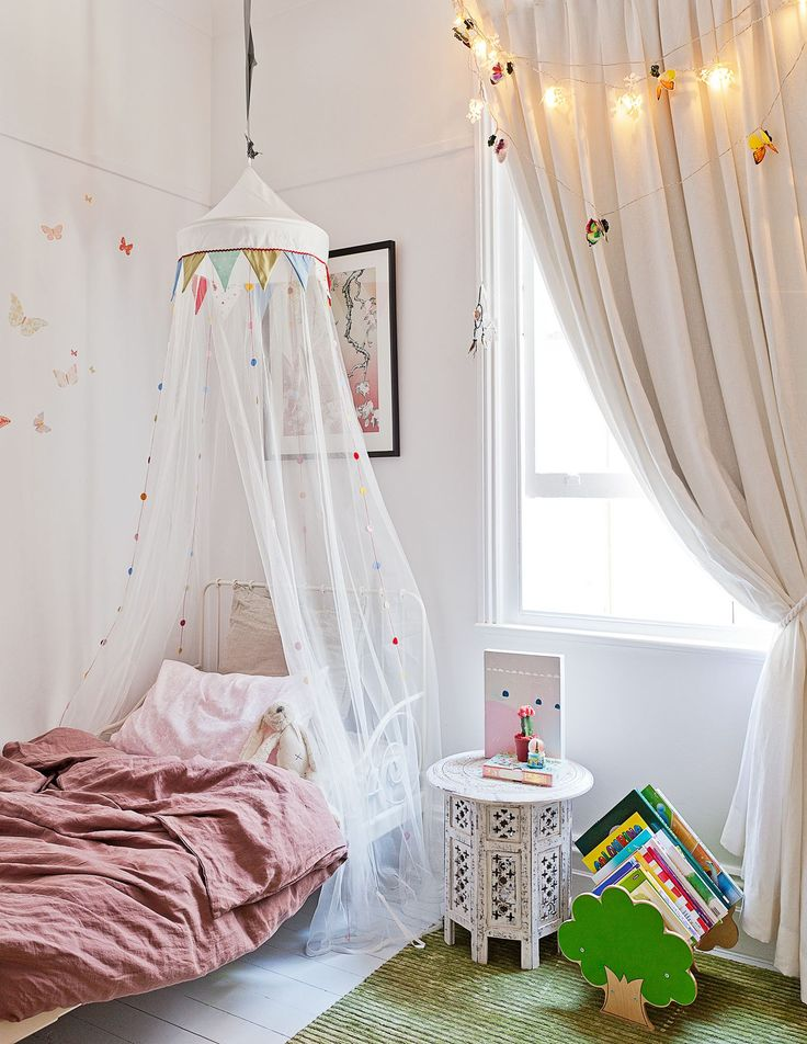 "Harper's bedroom is on the ground floor in the old part of the house. The Ikea ""Minnen"" bed is dressed with bedlinen from Little White Home. Beside it sits a My Escape Collection ""Tree"" bookcase from Go Home and a Moroccan side table from Touchwood Furniture in Sydney's Bronte."