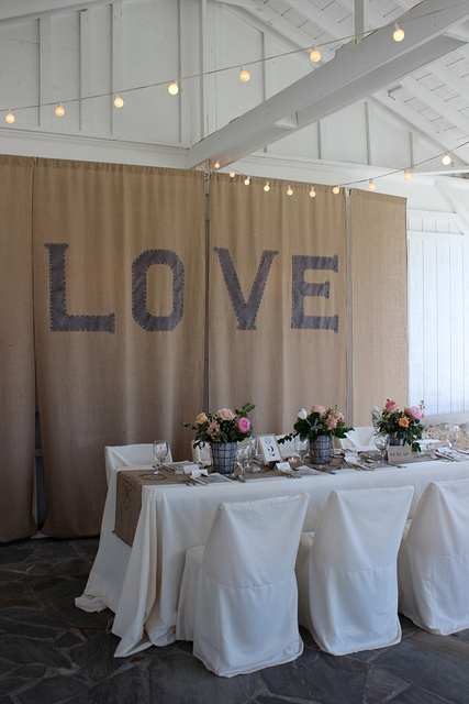 Burlap backdrop - could be cool of your wanted to put a big fancy word or something up.