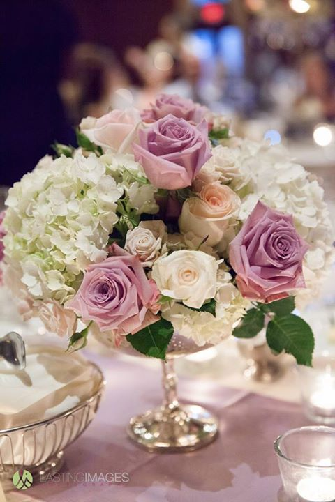 Pastel Purple Roses And White Hydrangea Centerpiece In A