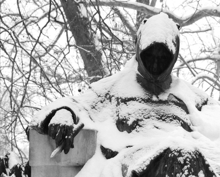 A cowled monk sits forever contemplating life, ledger to hand, in Varosliget, Budapest.  Snow falls past his sightless gaze...
