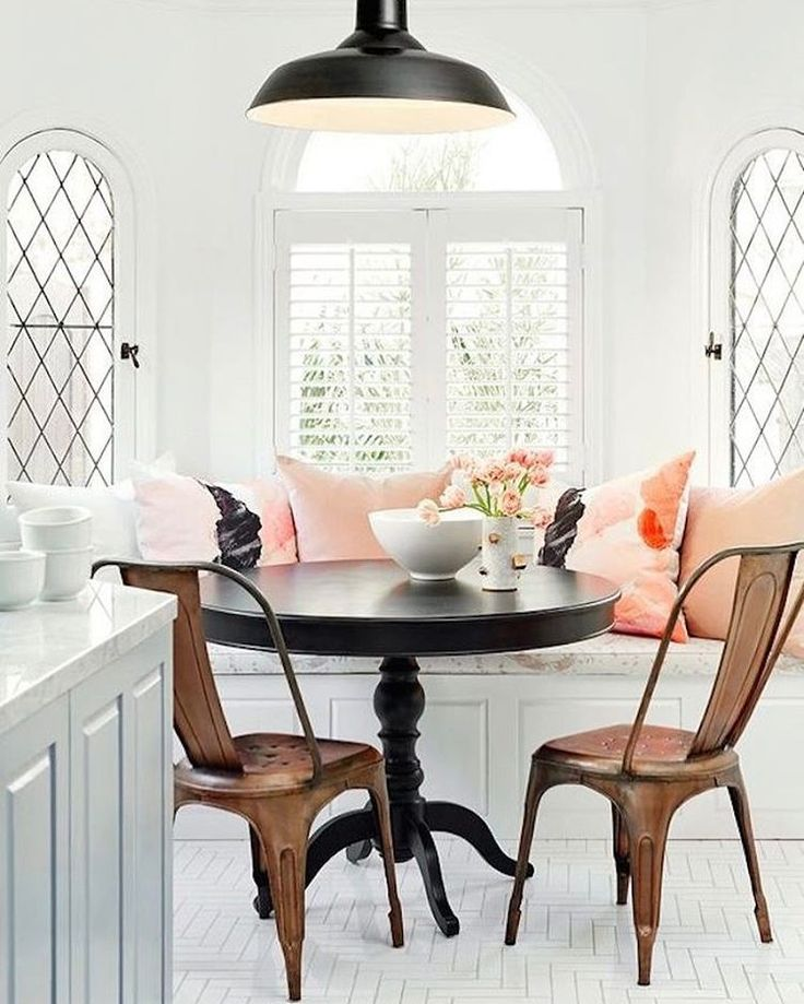 Design trend love--black accents in the dining room. Especially in this white dining nook paired with copper and blush.