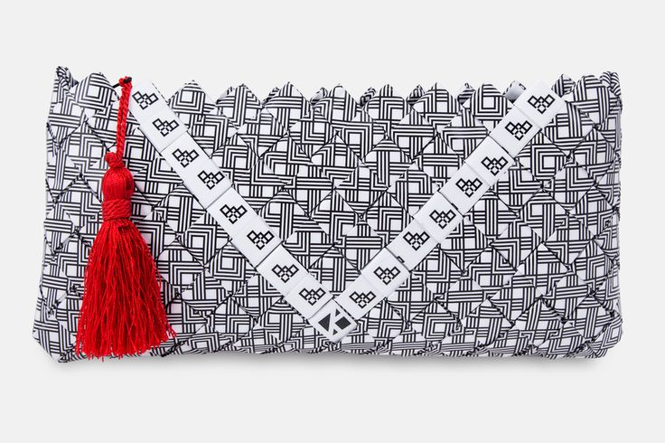 Handmade clutch bag based on geometric pattern (gestalten pattern). Accompanied by a black zipper and a red handmade tassel of silk thread for pendant.  The pattern is digitally printed and enriched with a professional photographic plastic; providing UV protection in order to maintain and protect the colors adding 100% waterproofness.