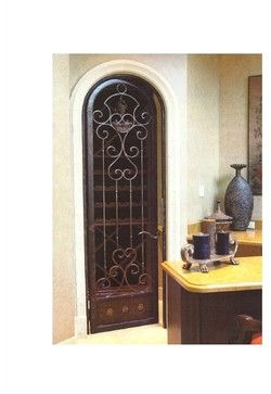Wrought Iron Wine Cellar Arched Door - mediterranean - interior doors - miami - DecoDesignCenter.com